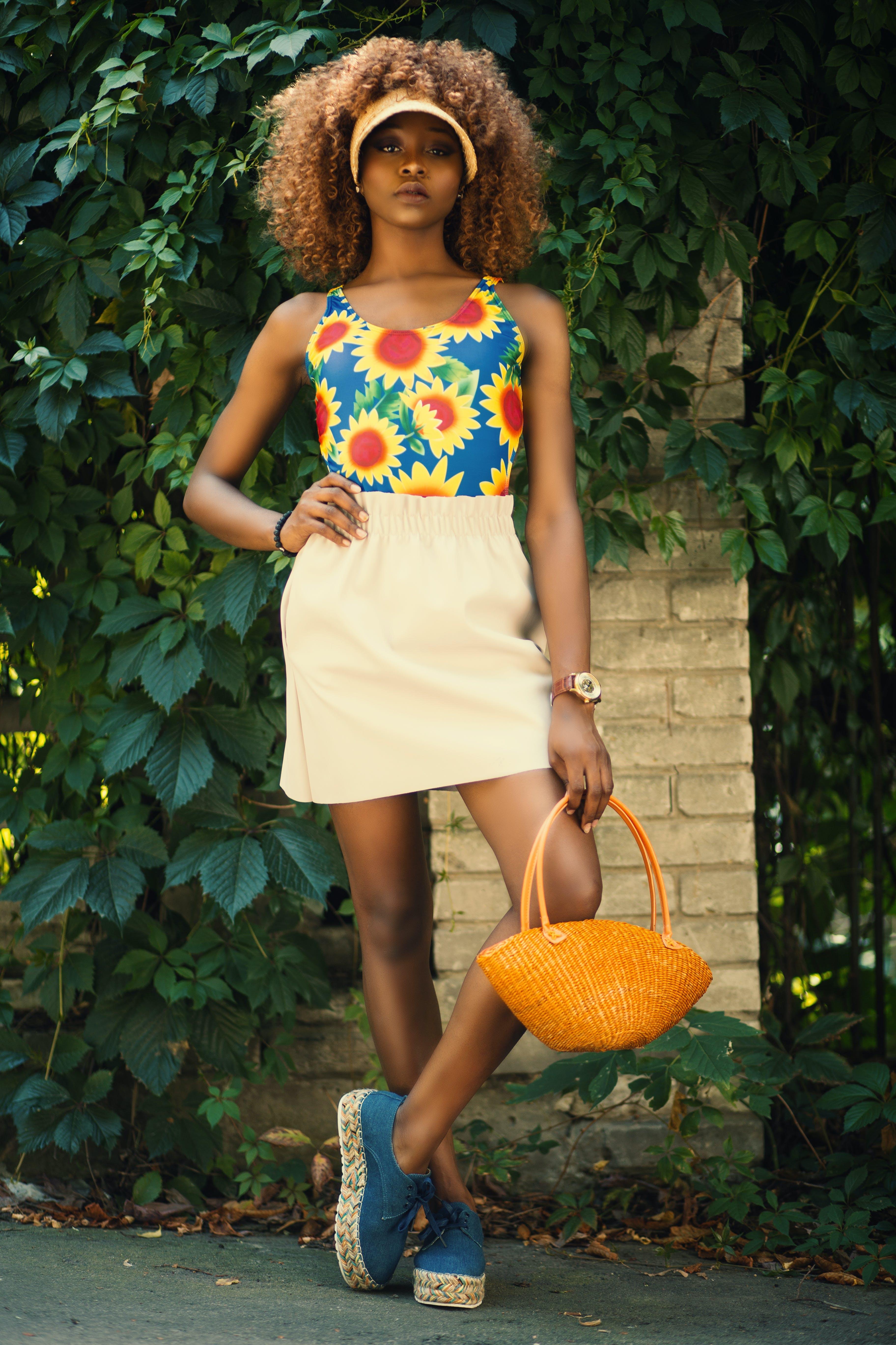 Woman Holding Orange Basket