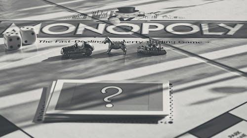 Monochrome Photo of Monopoly Items