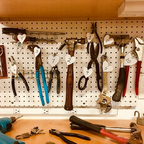 Handheld Tools Hang on Workbench