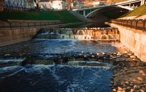 Waterfalls Near Bridge during Day