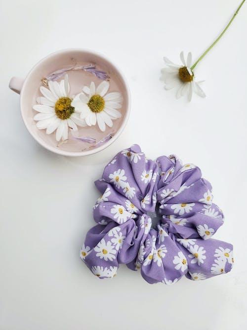 Purple and White Flower on White Ceramic Saucer