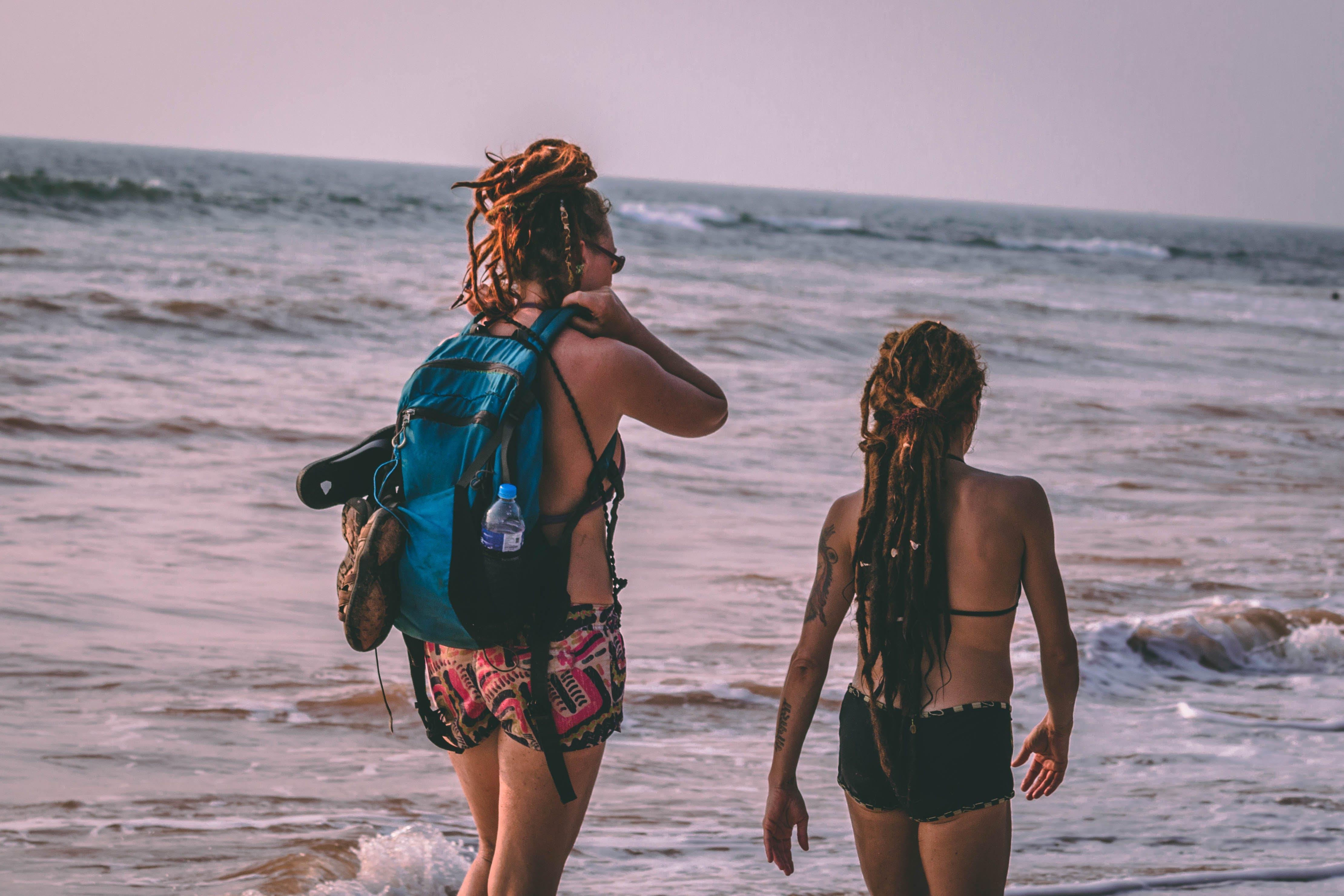 Two Woman Wearing Bikini Beside Seashore