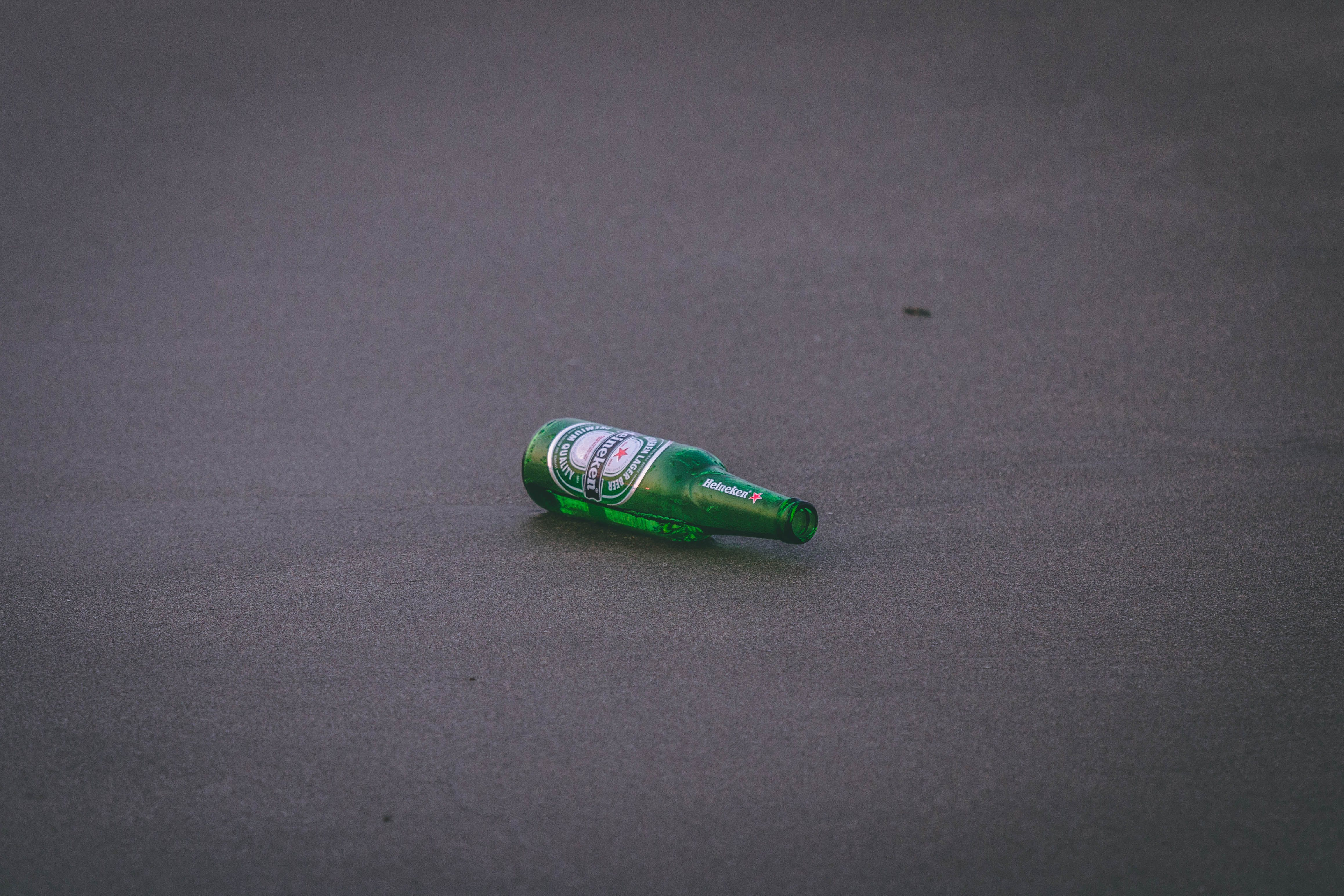 Empty Heineken Bottle on Ground