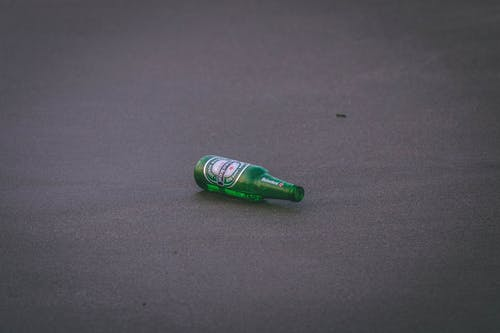 Empty Heineken Bottle on Ground