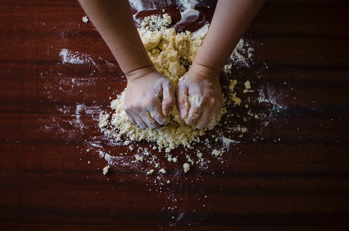 Person Mixing Dough