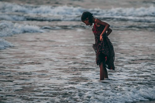 Girl Standing on Seashore