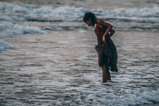 Girl Standing on Seashore