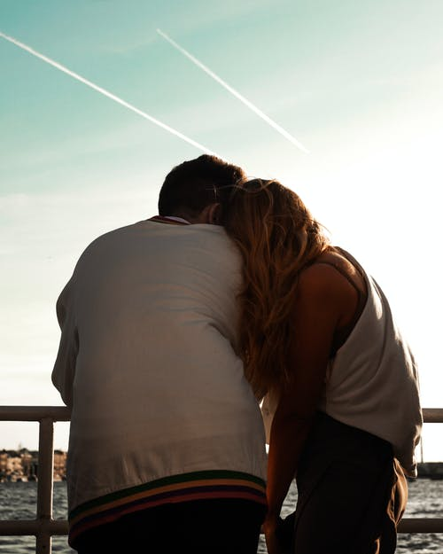 Back View of a Couple Hugging Each Other