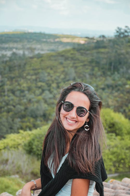 Smiling Woman Wearing a Sunglasses