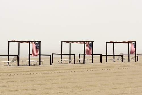 Free stock photo of American flags, beach, minimalist