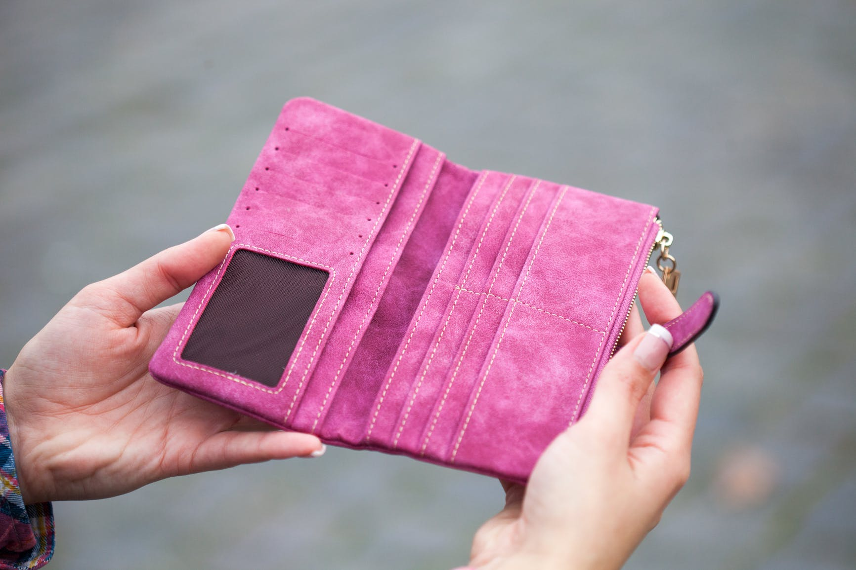 Person Holding Pink Suede Long Waller