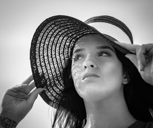 Grayscale Photo of Woman Wearing Sun Hat