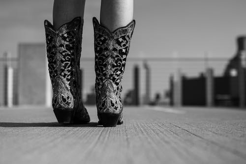 Grayscale Photo of Cowboy Boots