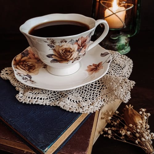 A Cup of Coffee on Top of Stack of Books