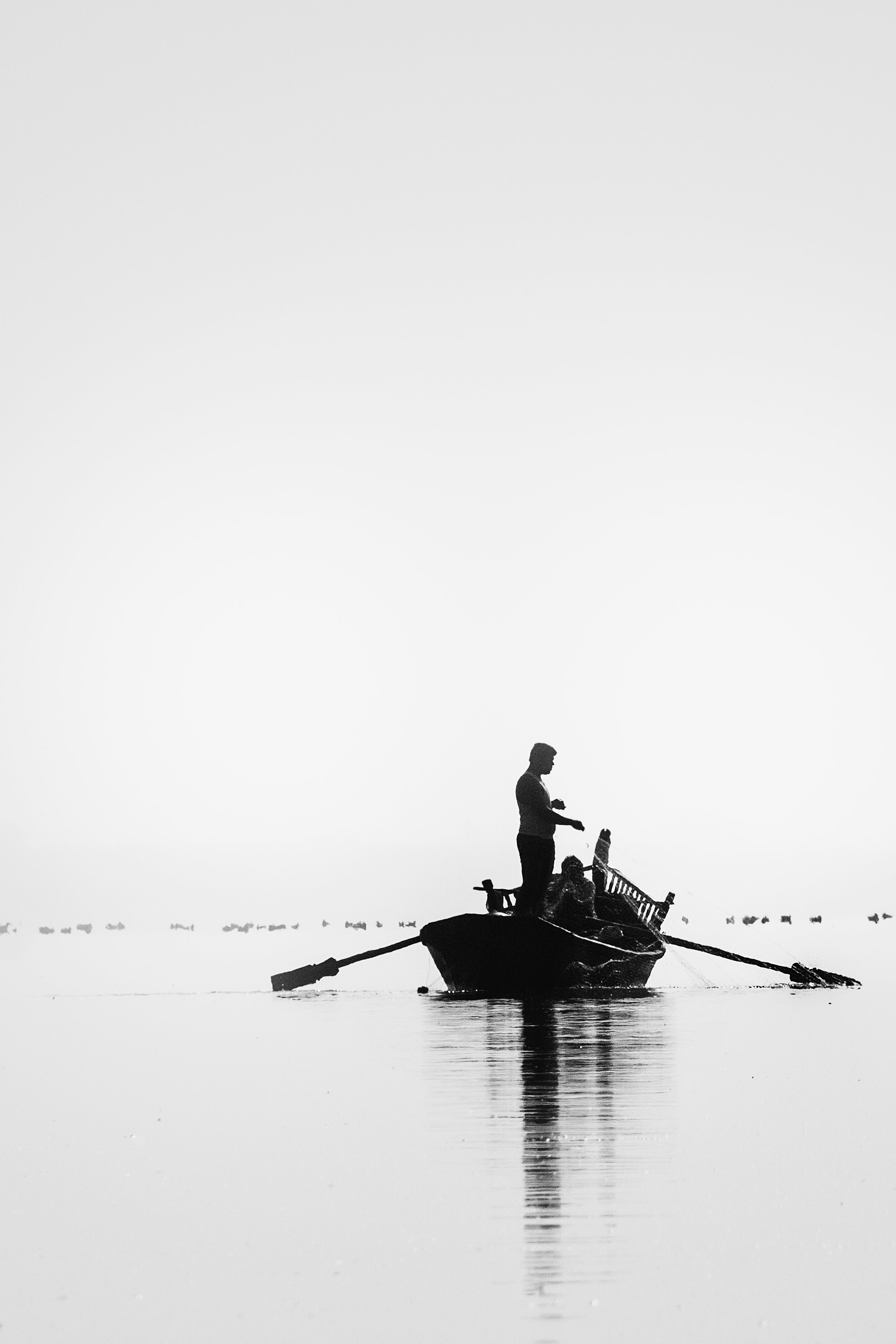 Grayscale Picture of Two People Go on Fishing