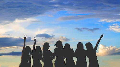 Silhouette Photo Of Women Under Blue Sky