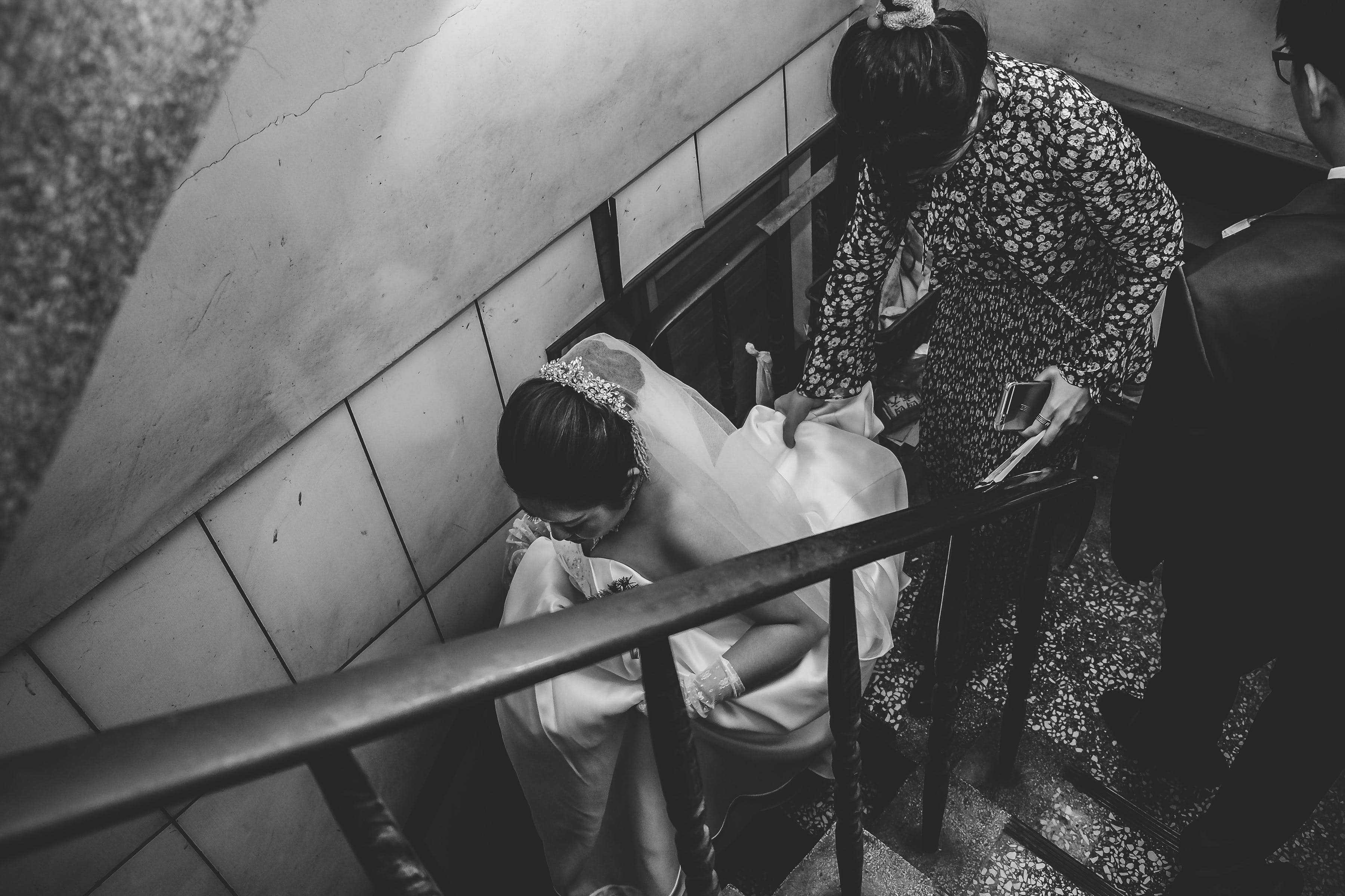 Grayscale Photography of Bride on Stair