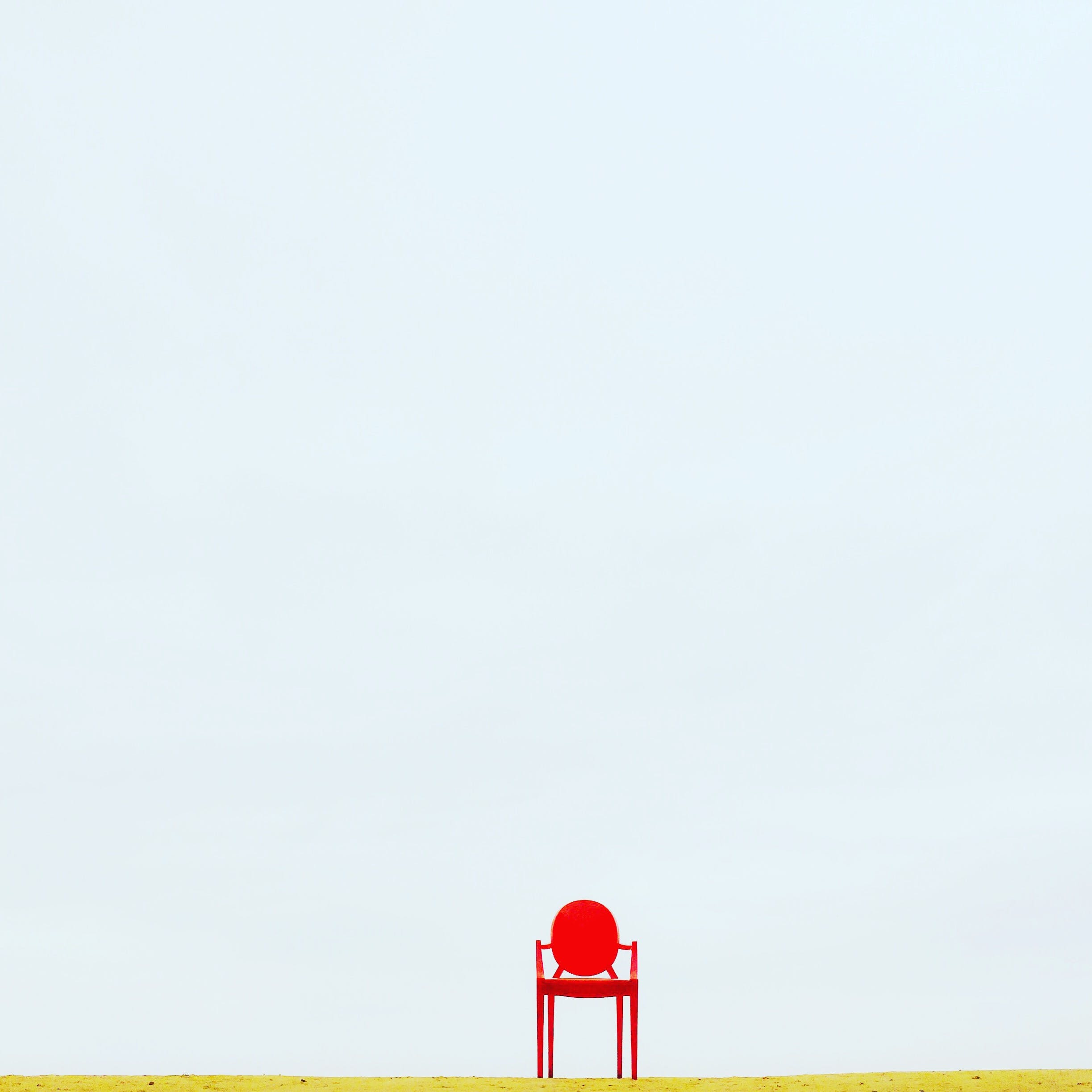 Red Armchair on Brown Surface