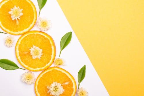 Sliced Orange Fruit on White Floral Plate