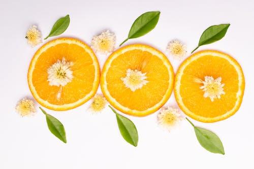 Sliced Orange Fruits on White Surface