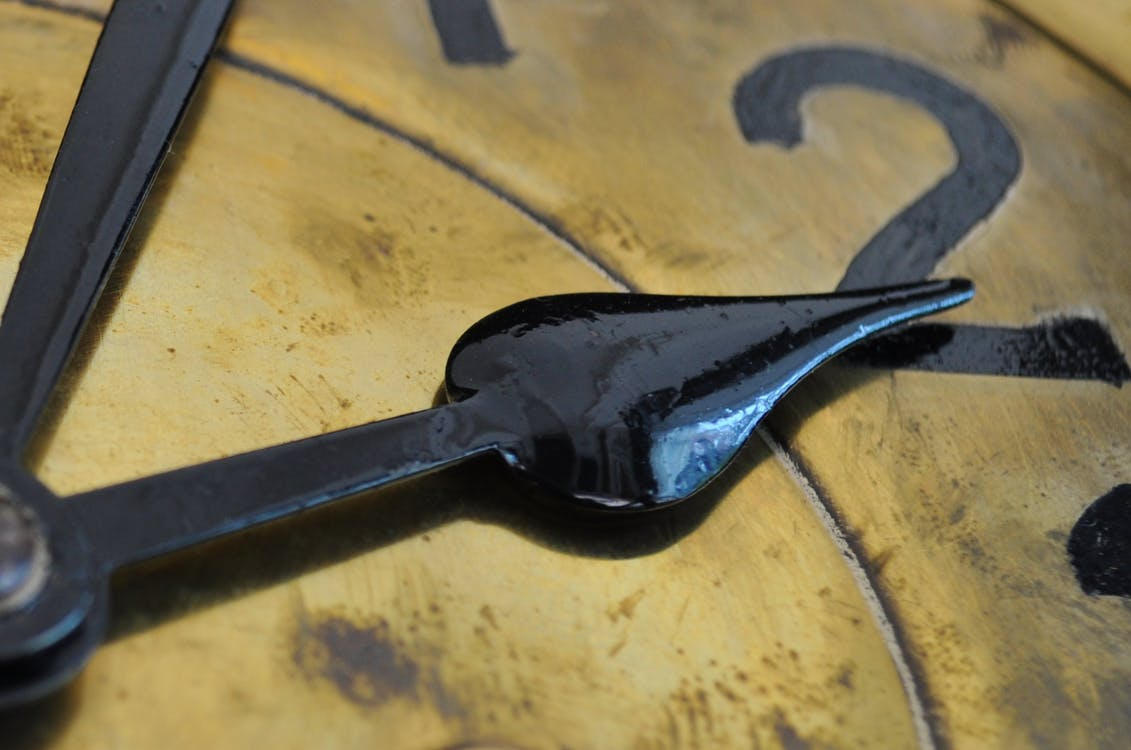 Close-Up Photo of Clock Pointing at 2
