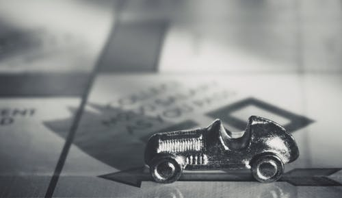 Miniature Item on Monopoly Board Game