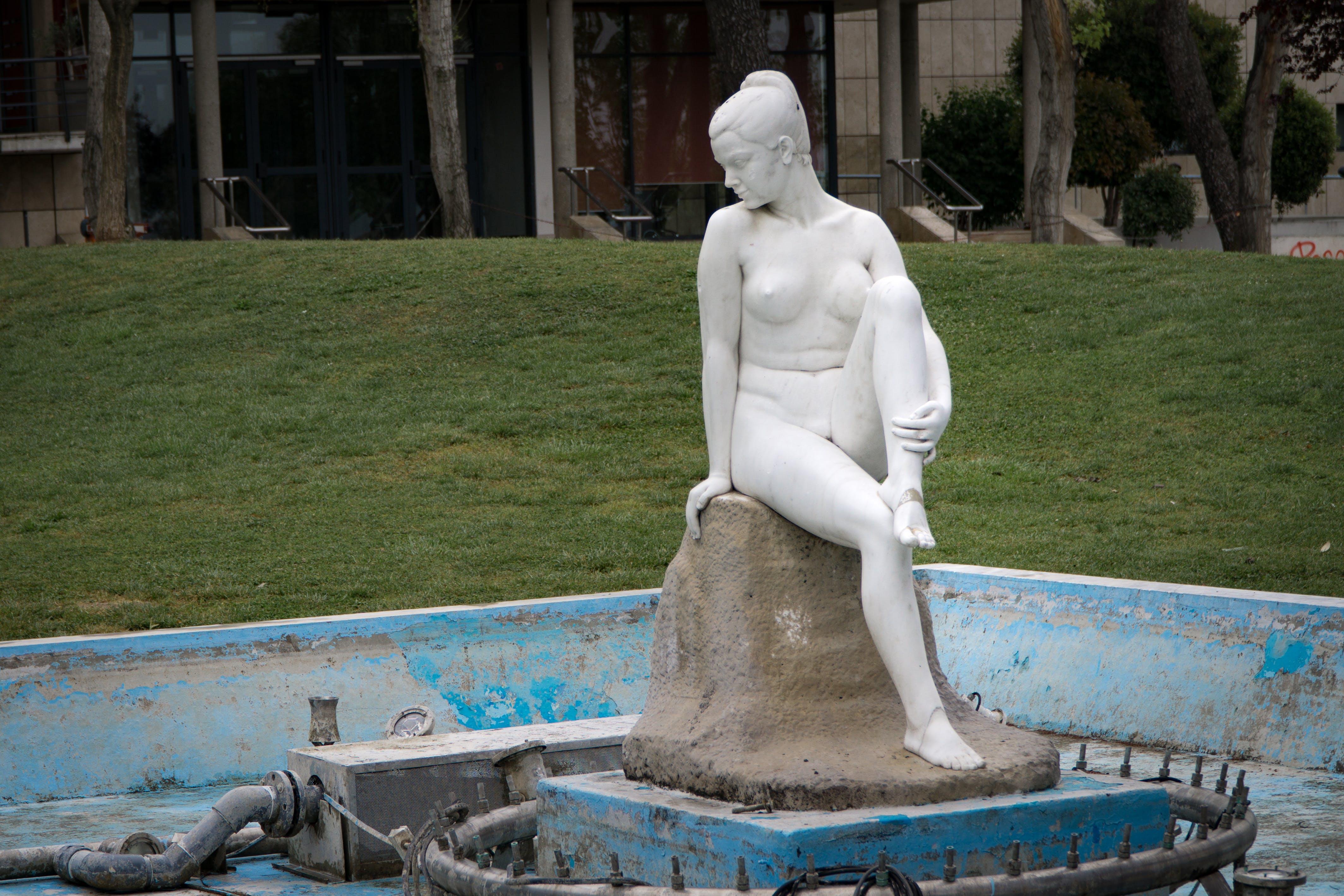 Naked Woman White Concrete Statue Near Green Grass
