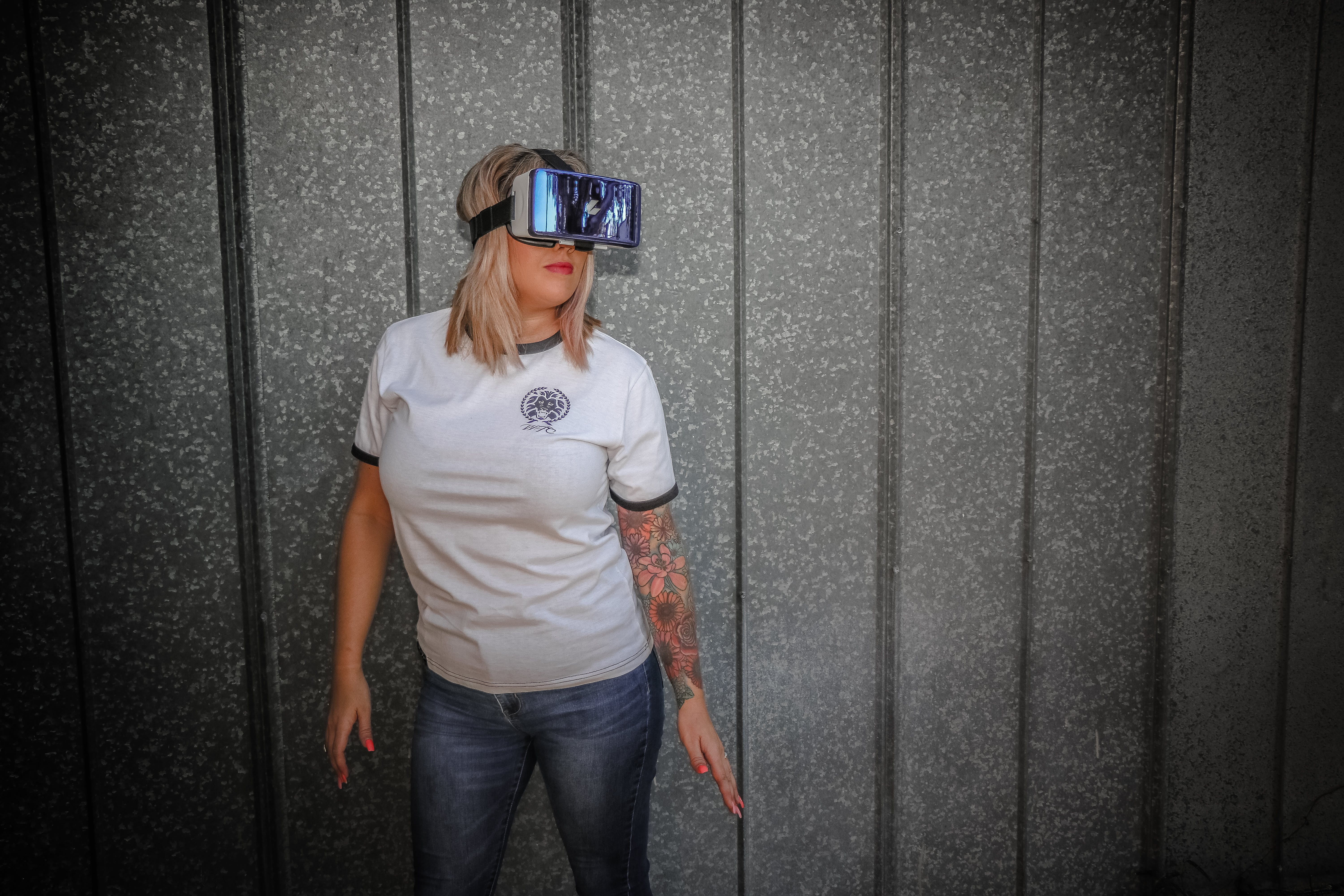 Photograph of Woman Wearing Vr Glass in Front of Wall