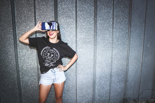 Woman in Black Crew-neck T-shirt Wearing Blue Vr Goggles