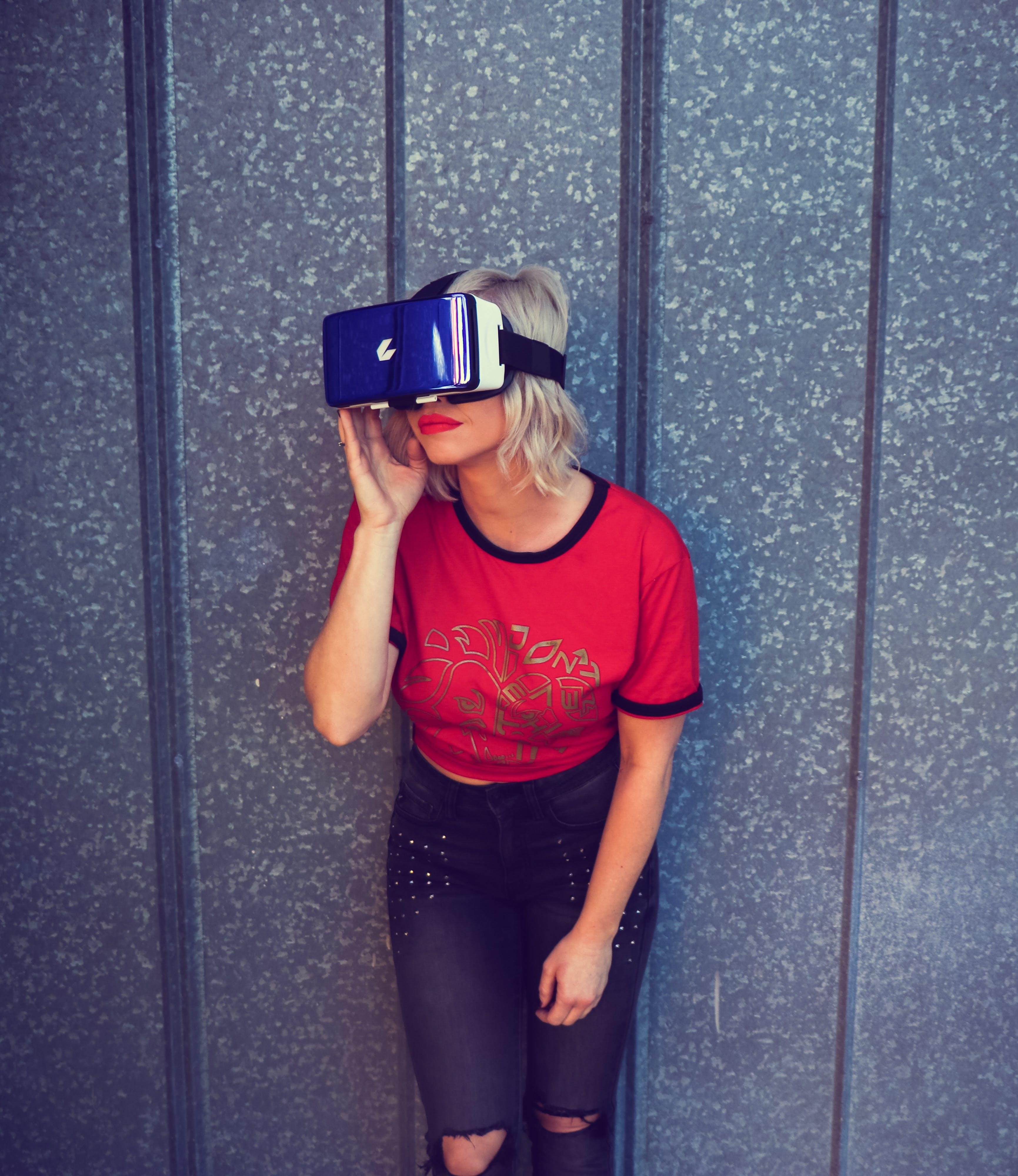 Photo of a Woman Wearing Virtual Reality Headset