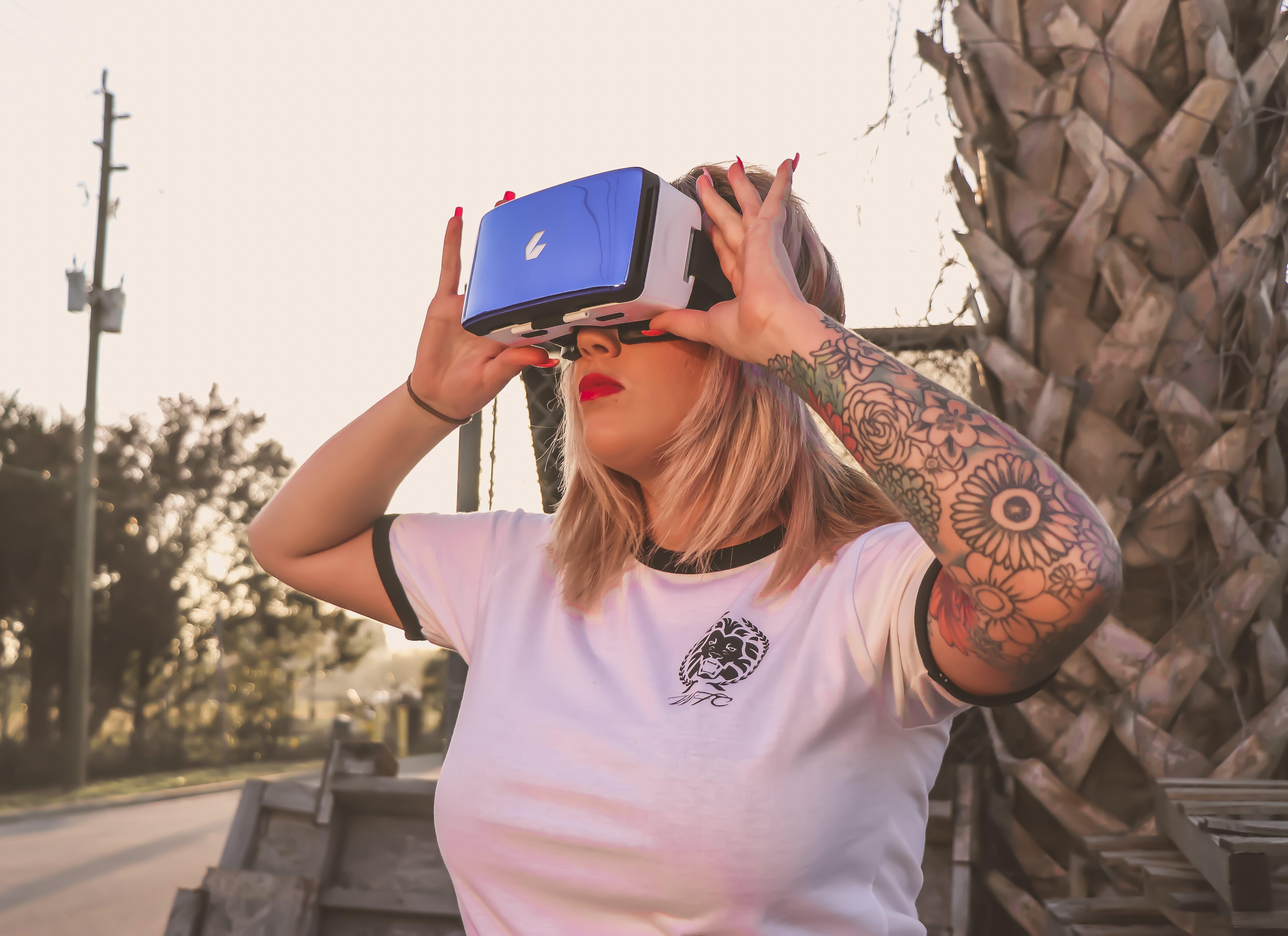 Photo of a Woman Using Virtual Reality Glasses