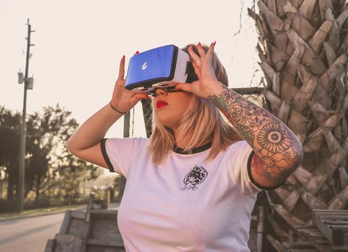 Photo of a Woman Using Virtual Reality Glasses
