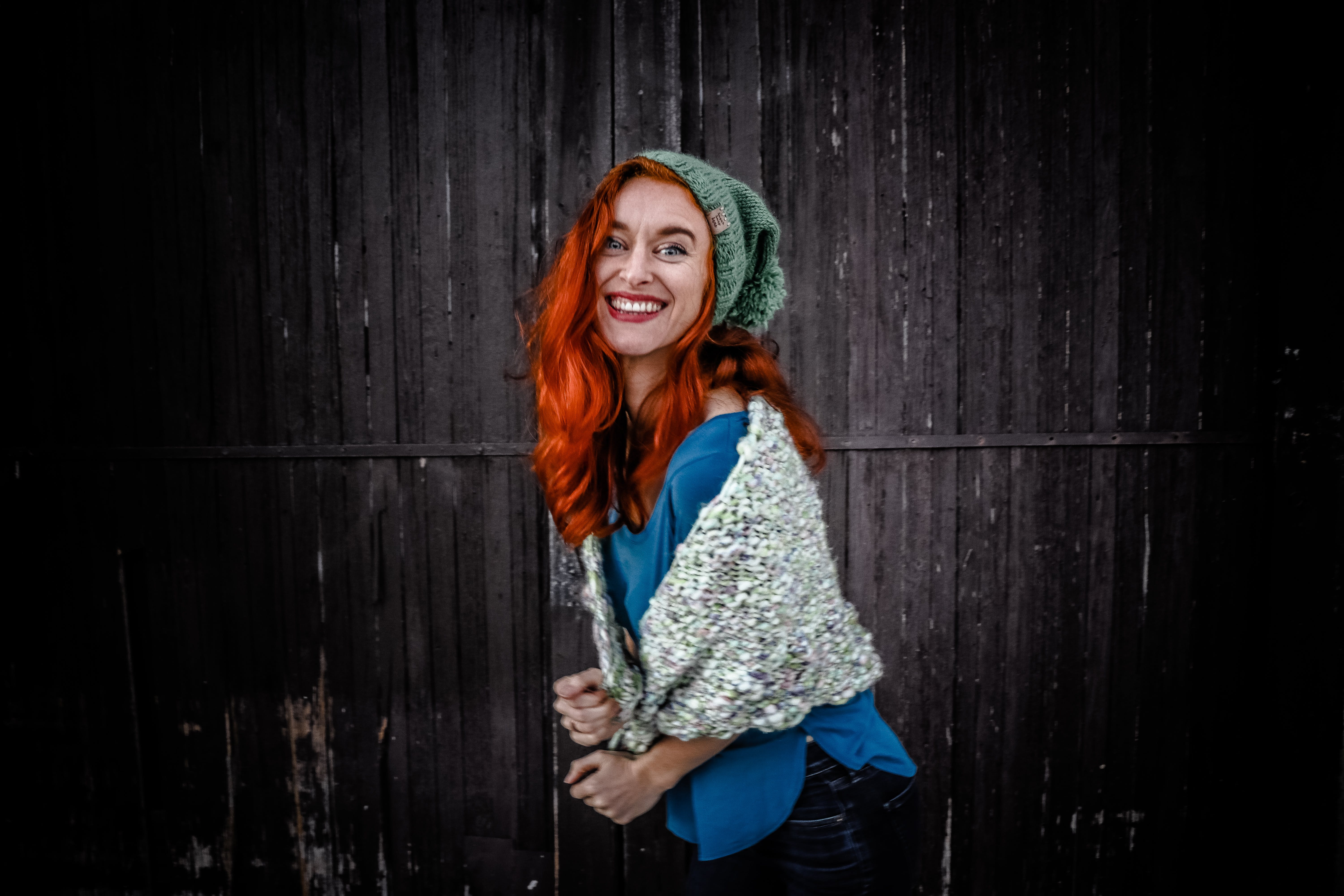 Woman in Blue Shirt an White Scarf With Red Hair
