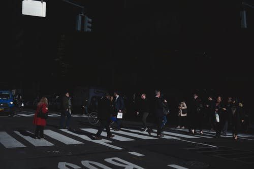 Photo of People Walking on Pedestrian Crossing