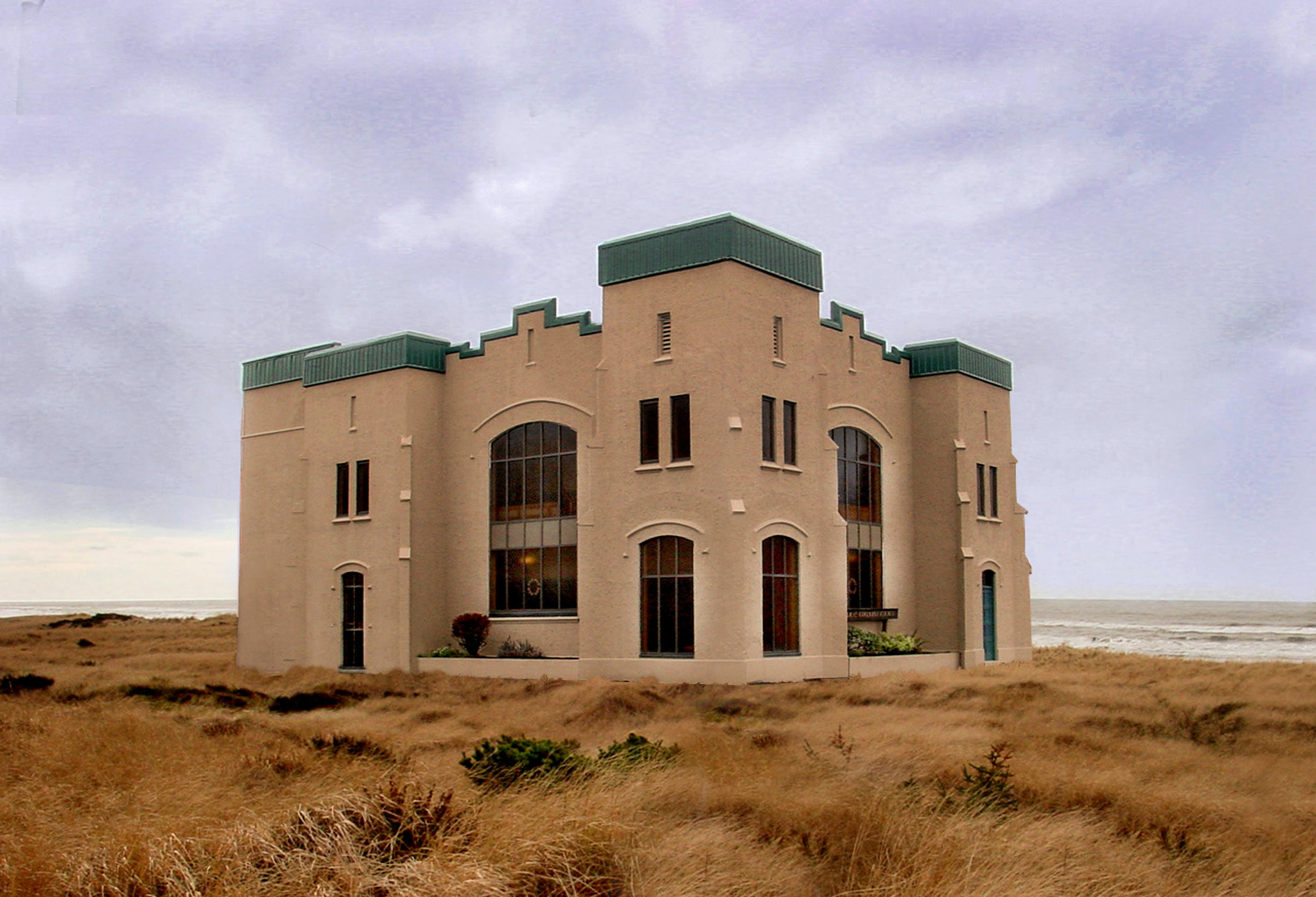 Brown Concrete Mansion at the Middle of Nowhere