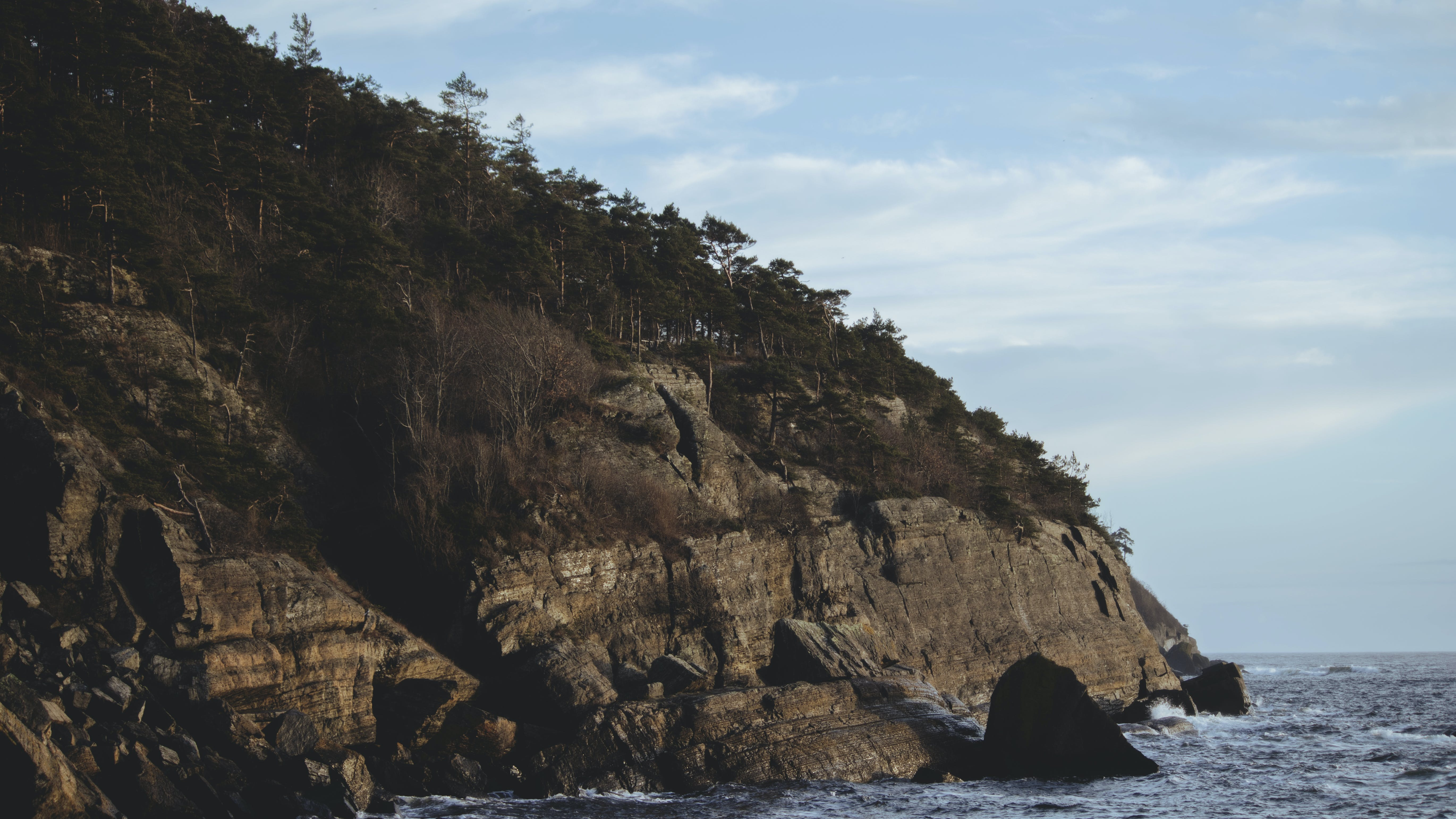 Landscape Photography of Cliff and Ocean