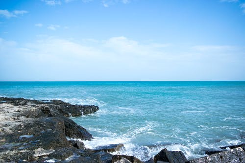 Photos gratuites de cailloux, côte, eau, horizon