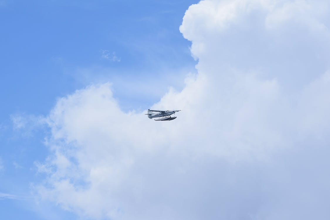 White Hydroplane Flying on the Sky