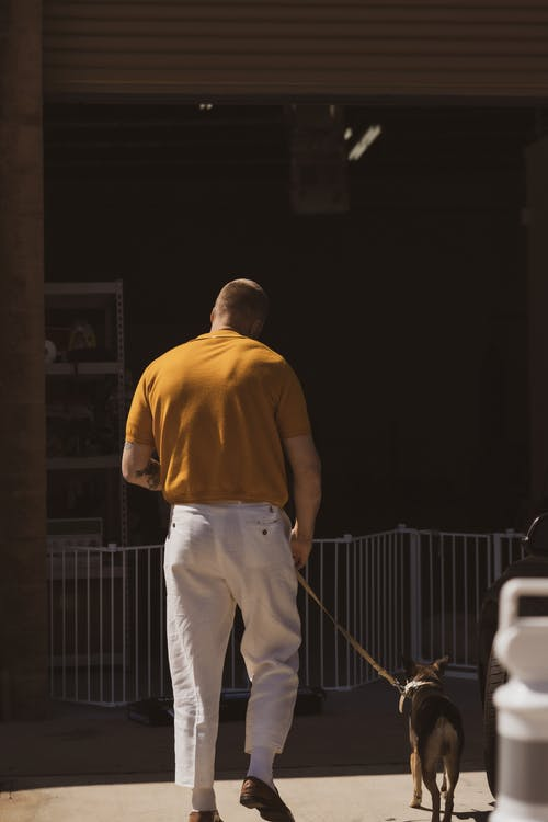 Man in Yellow Polo Shirt and White Pants Standing