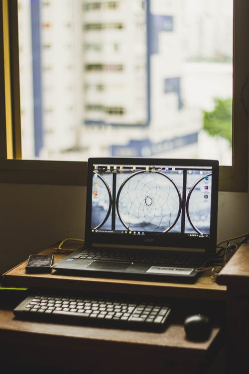 Turned on Laptop on Desk