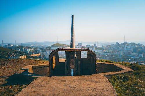 A Rusted Artillery Facing the City