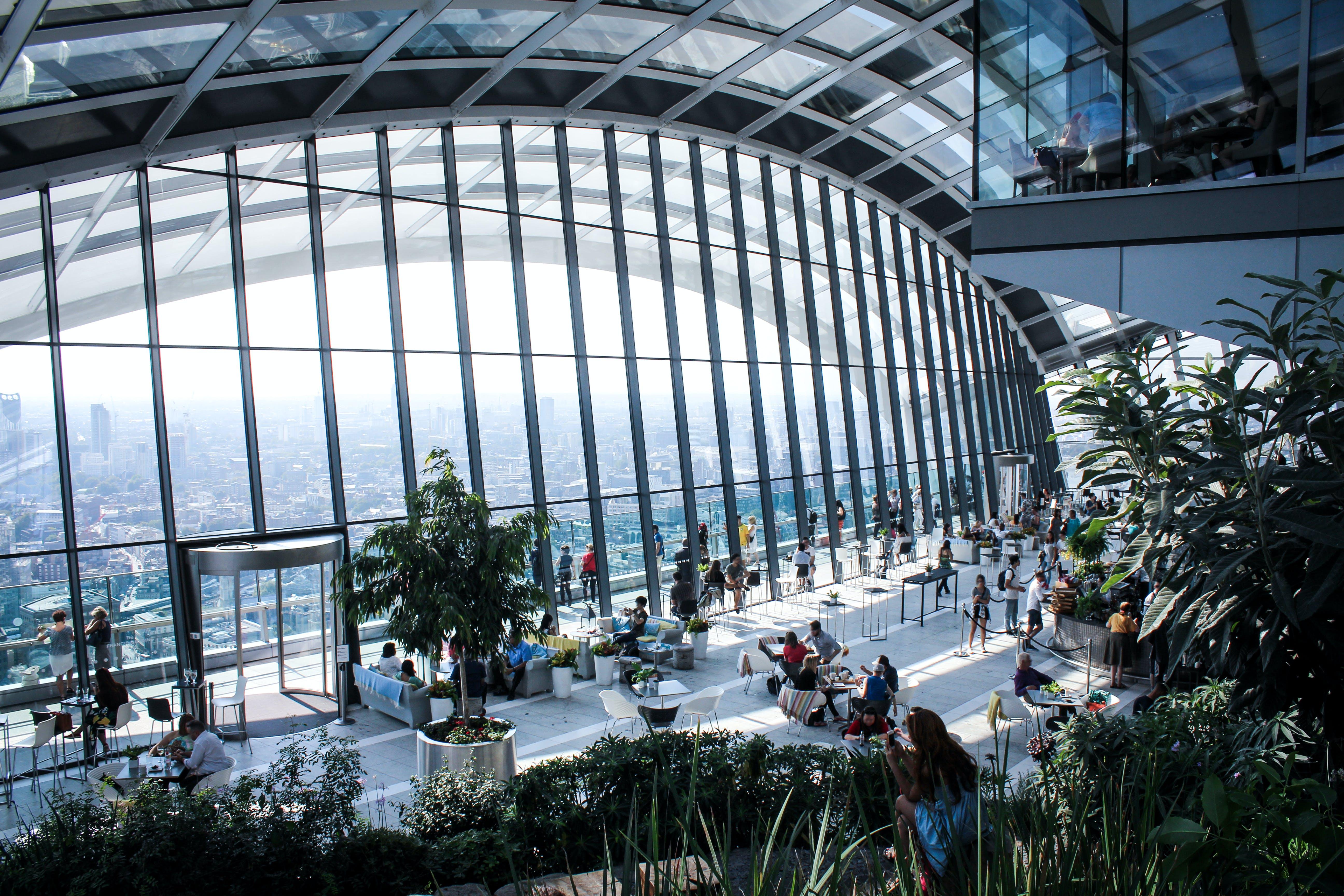 Landscape Photo of People Inside Building