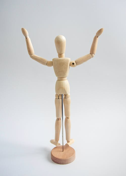 Wooden Human Figure on White Table
