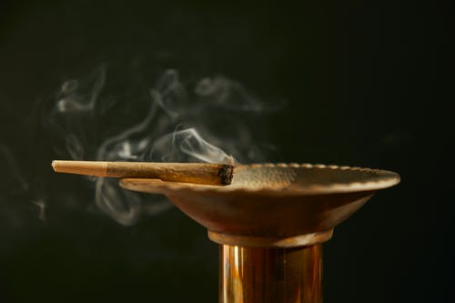 Brown Wooden Stand With White Smoke