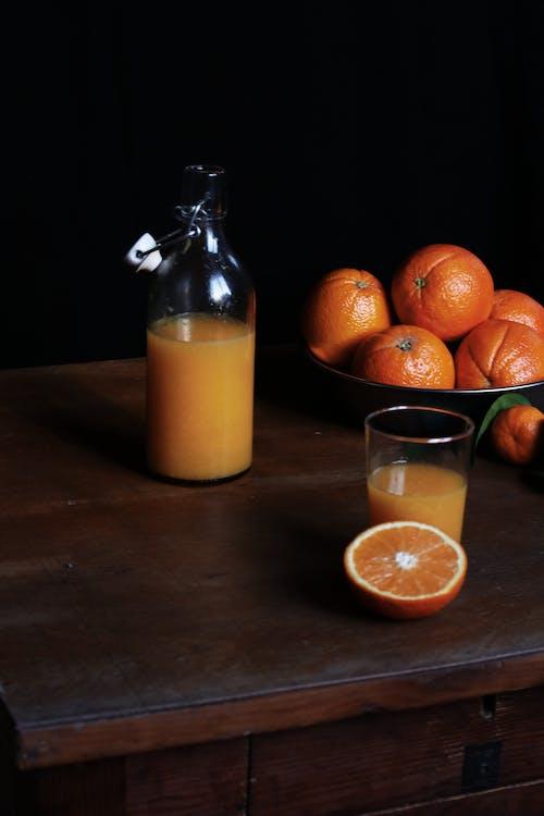 Gratis stockfoto met drinkglas, glas, glazen fles