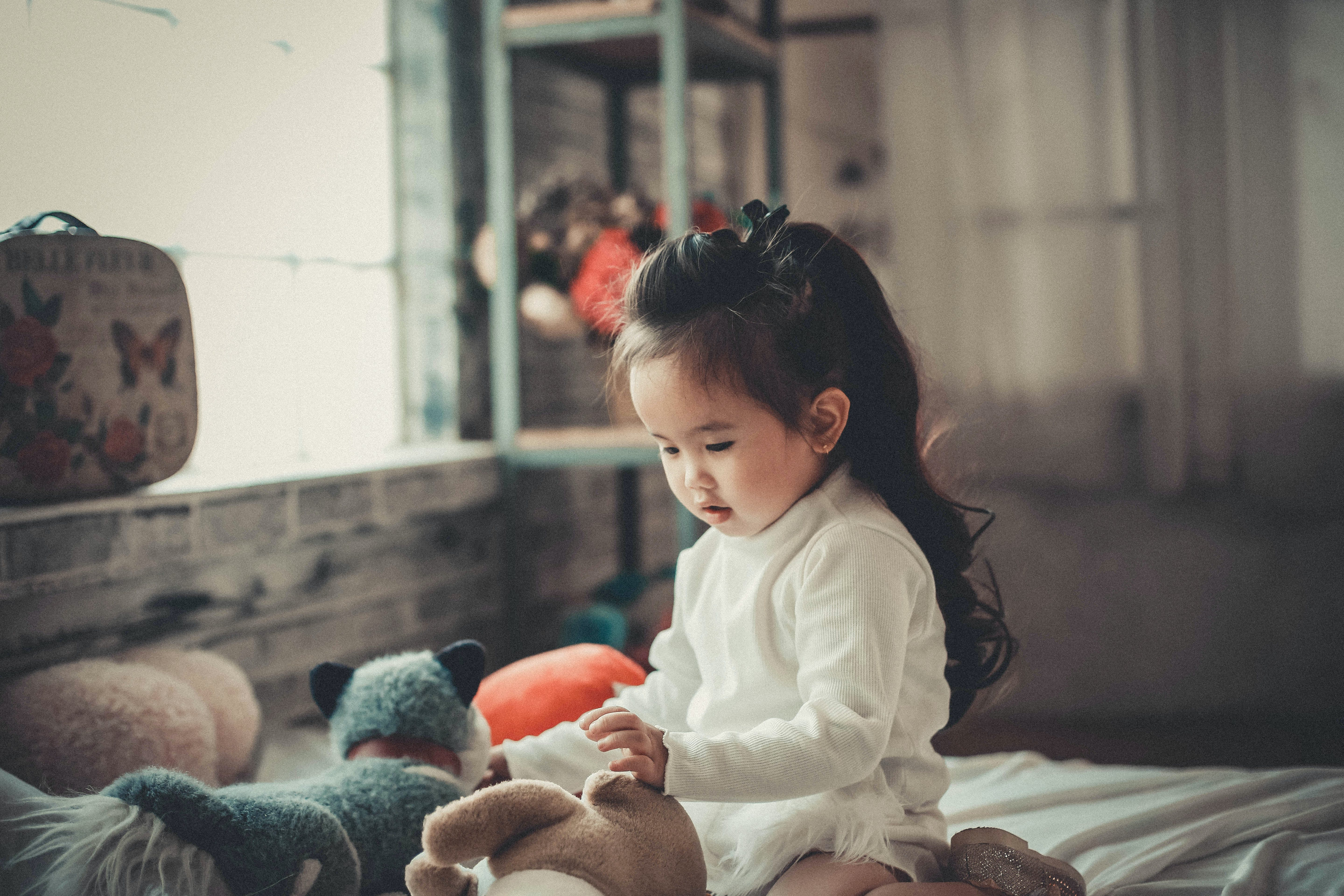Photography of a Baby Girl Playing
