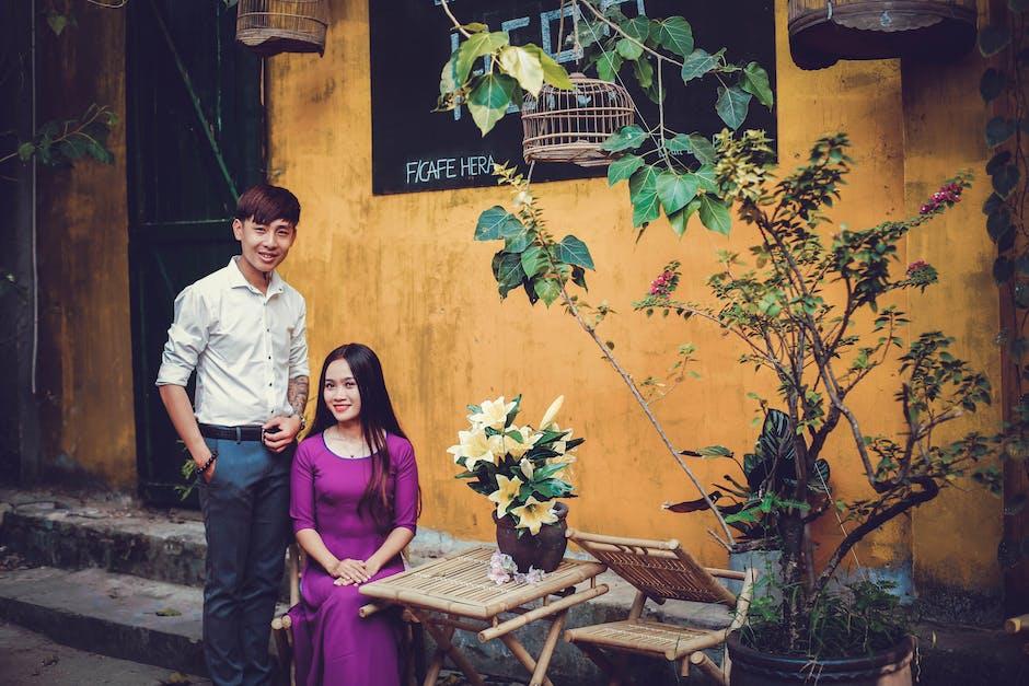 Sitting Woman Wearing Purple Elbow-sleeved Dress and Standing Man Wearing White Dress Shirt