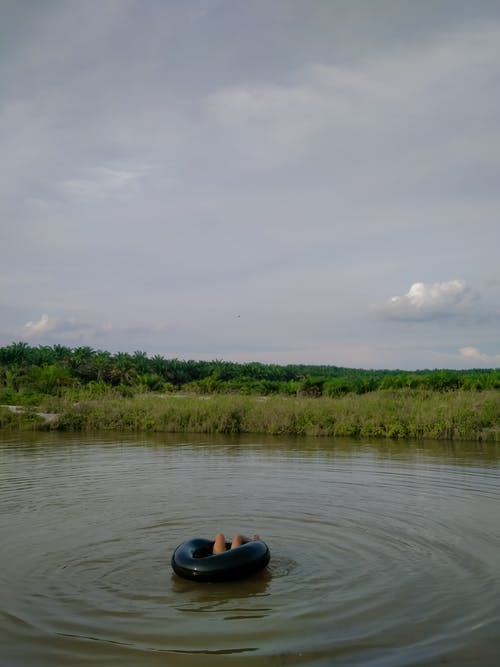 Person in Black Kayak on River