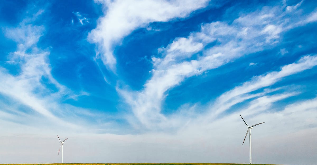 Two Wind Turbines Under Blue Sky · Free Stock Photo