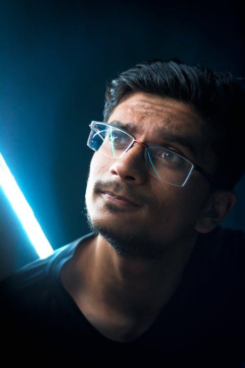 Man in Black Crew Neck Shirt Wearing Eyeglasses